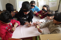 kids blindfolded and smiling